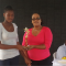 Winner of 2015 challenge (Left) collecting a cash prize from Jozel John
